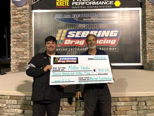 Titusville's John Platt Jr., left, and Scott Findlay show the winner's check.