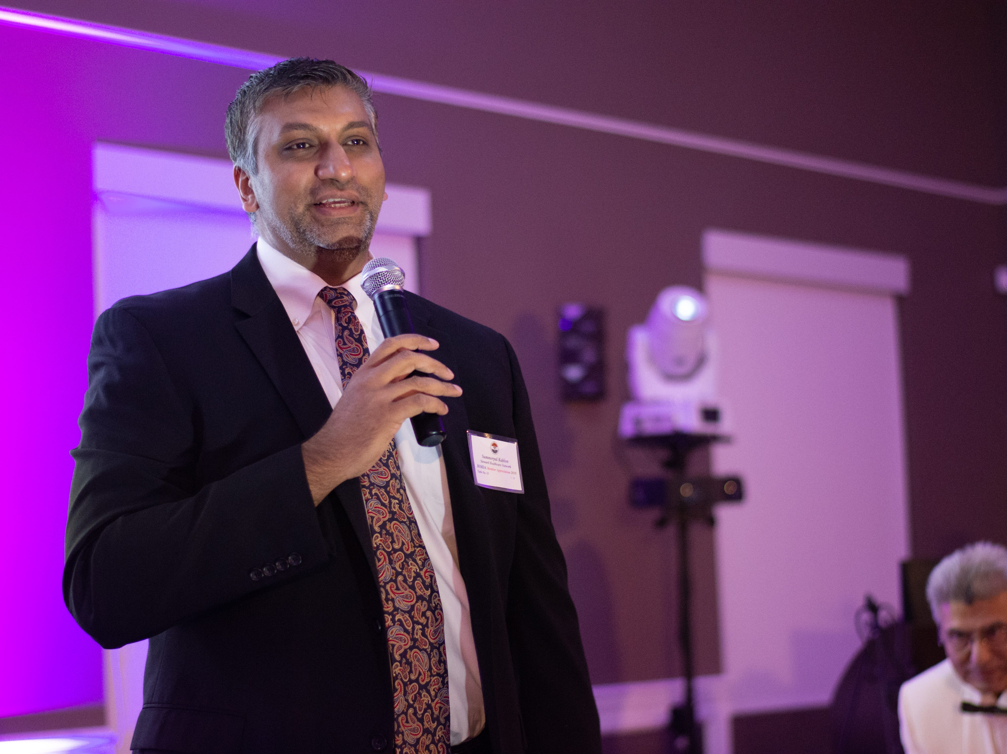 Steward Healthcare Network Chief Medical Information Officer Dr. Sumerpal Kahlon speaks during the ceremony.