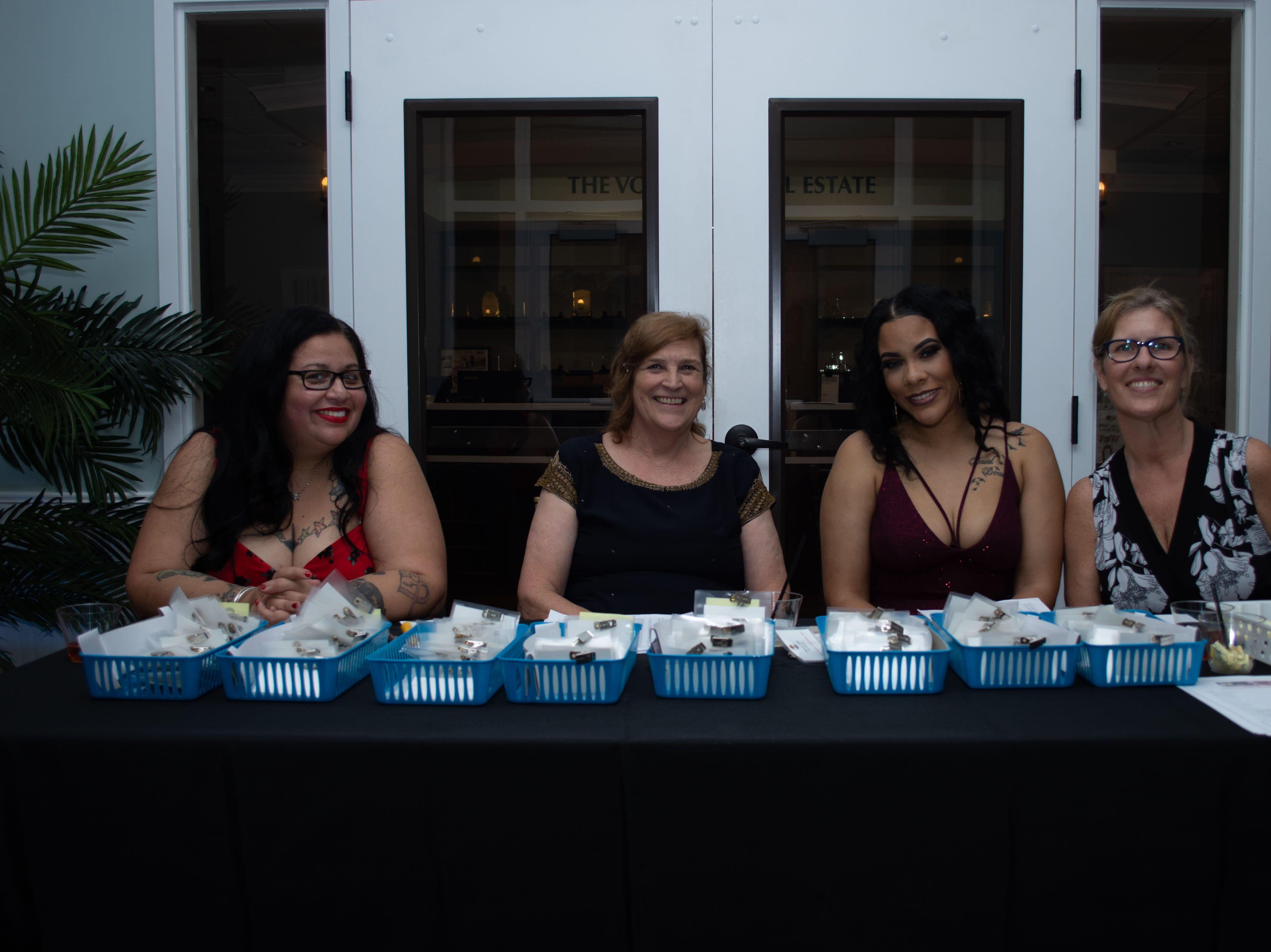 Check in table volunteers Yvonne Rountree, Roberta Arjona, Jasmin Delarosa, and Cindy Shirley.
