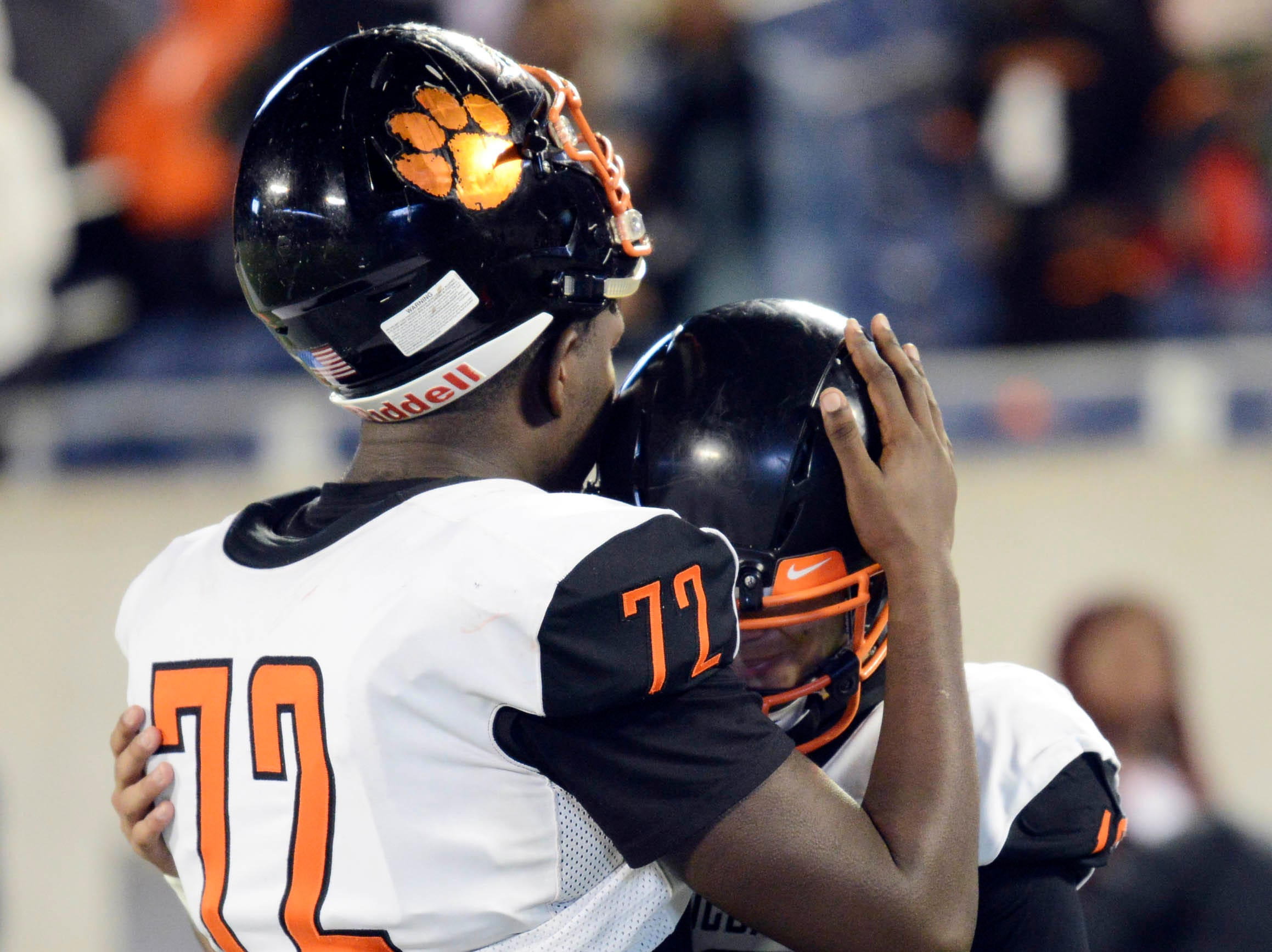 Cocoa's e Nicholas Parks hugs teammate Diego Arroyo following their 27-13 loss in Thursday's Class 4A football state championship.