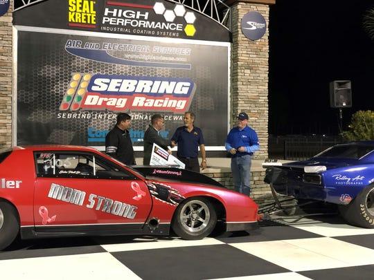 From left, Titusville's John Platt Jr; Scott Kaplin (sponsor Air and Electrical Services); Scott Findlay; and track announcer Mike Waldren.
