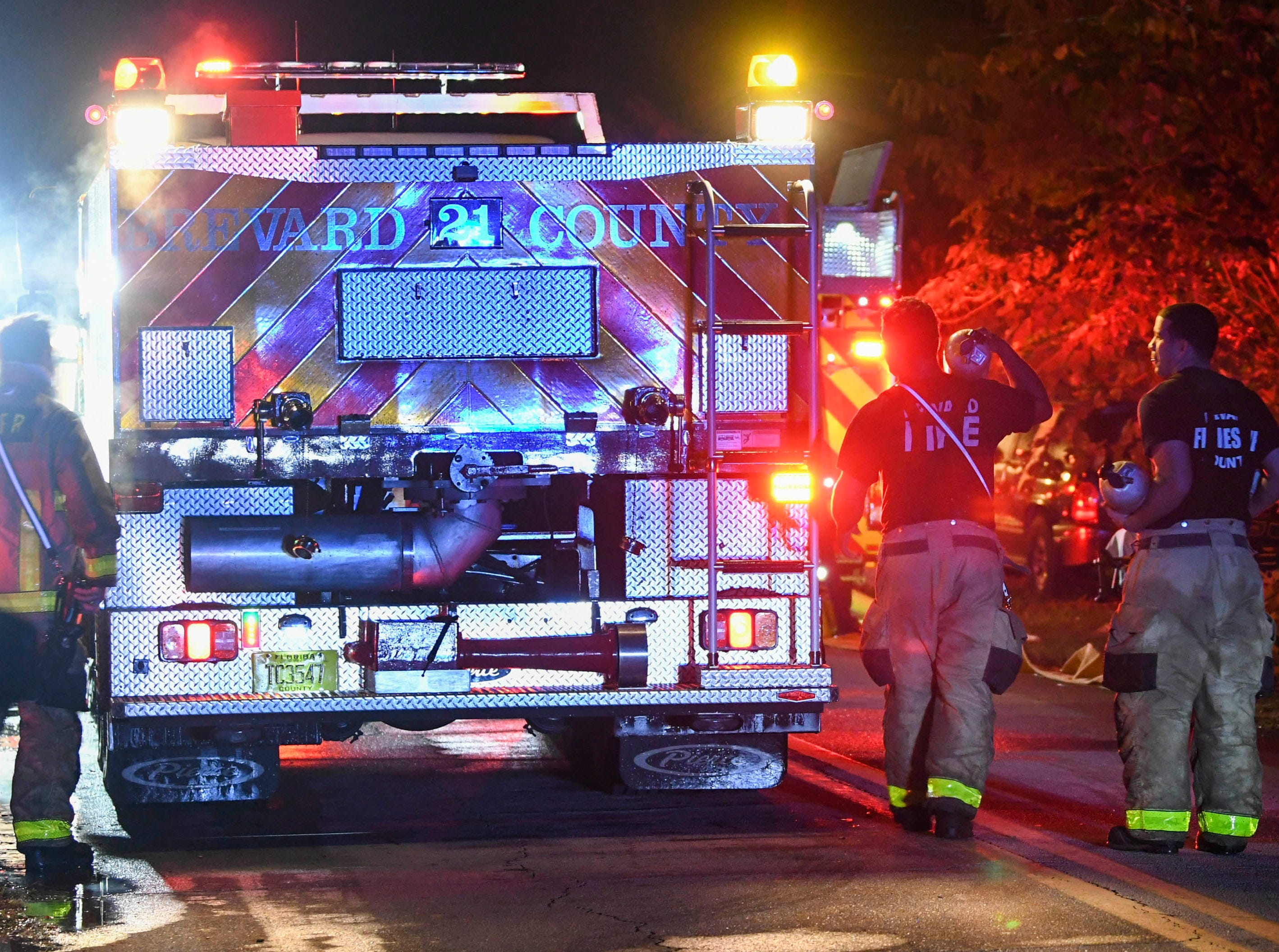 Brevard County firefighters mop up after a house fire on Brockett Rd. In Mims early Friday morning. The house was heavily damaged in the blaze.