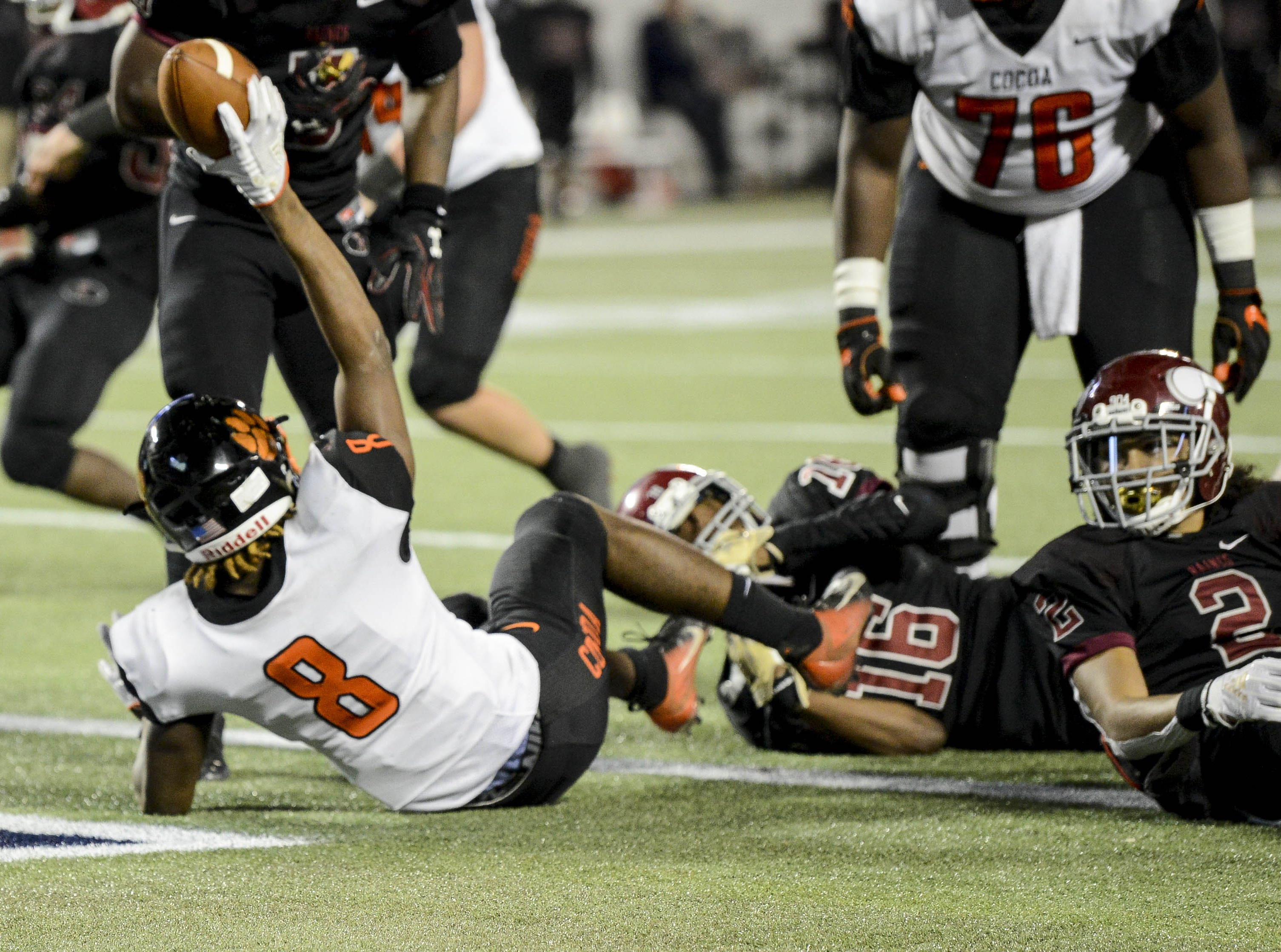 Caziah Holmes (8) scores a TD for Cocoa during Thursday's Class 4A football state championship.