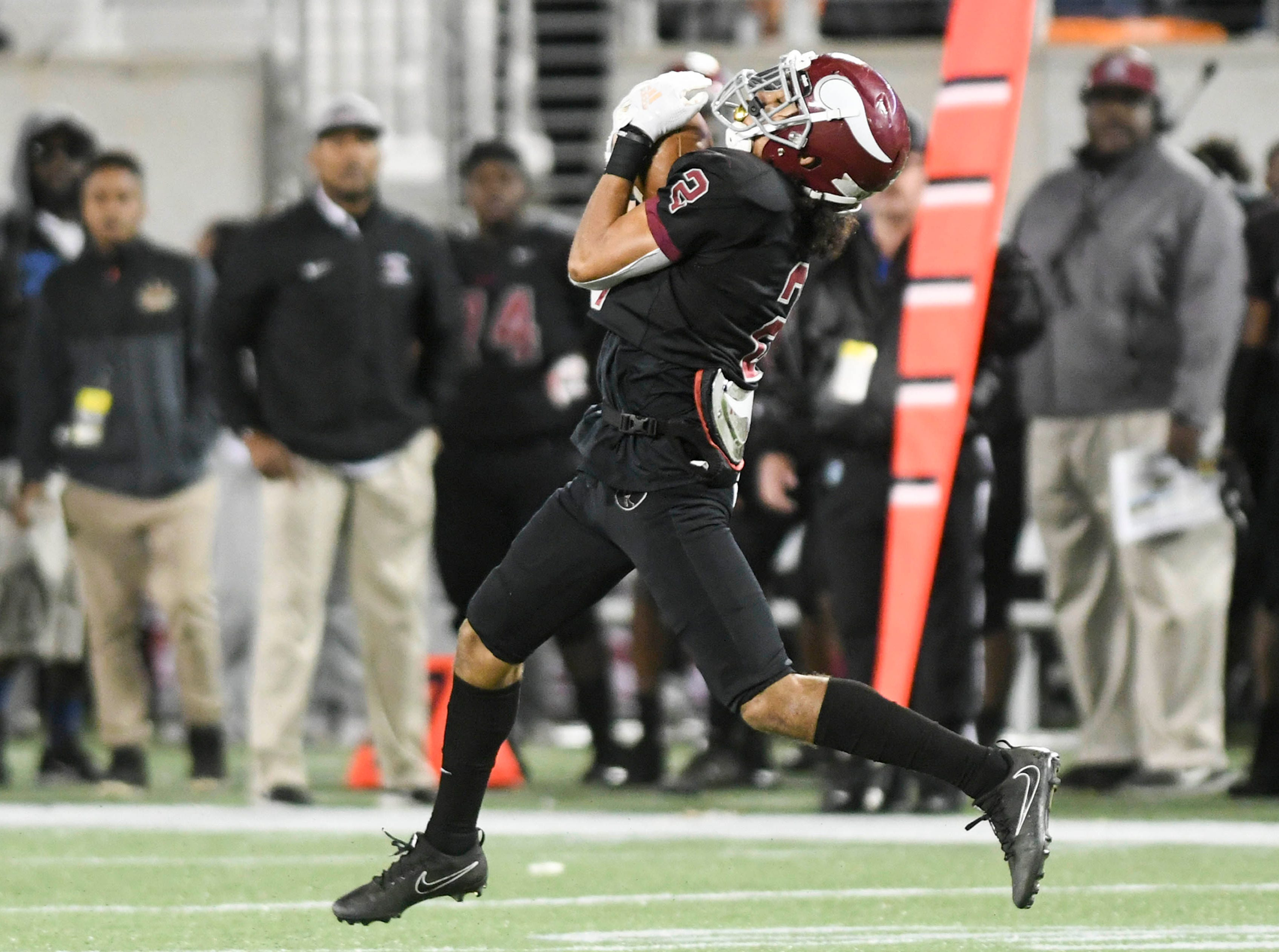 Treyvon Hobbs of Raines intercepts a Cocoa pass and returns it 66 yards for a touchdown during Thursday's Class 4A football state championship.