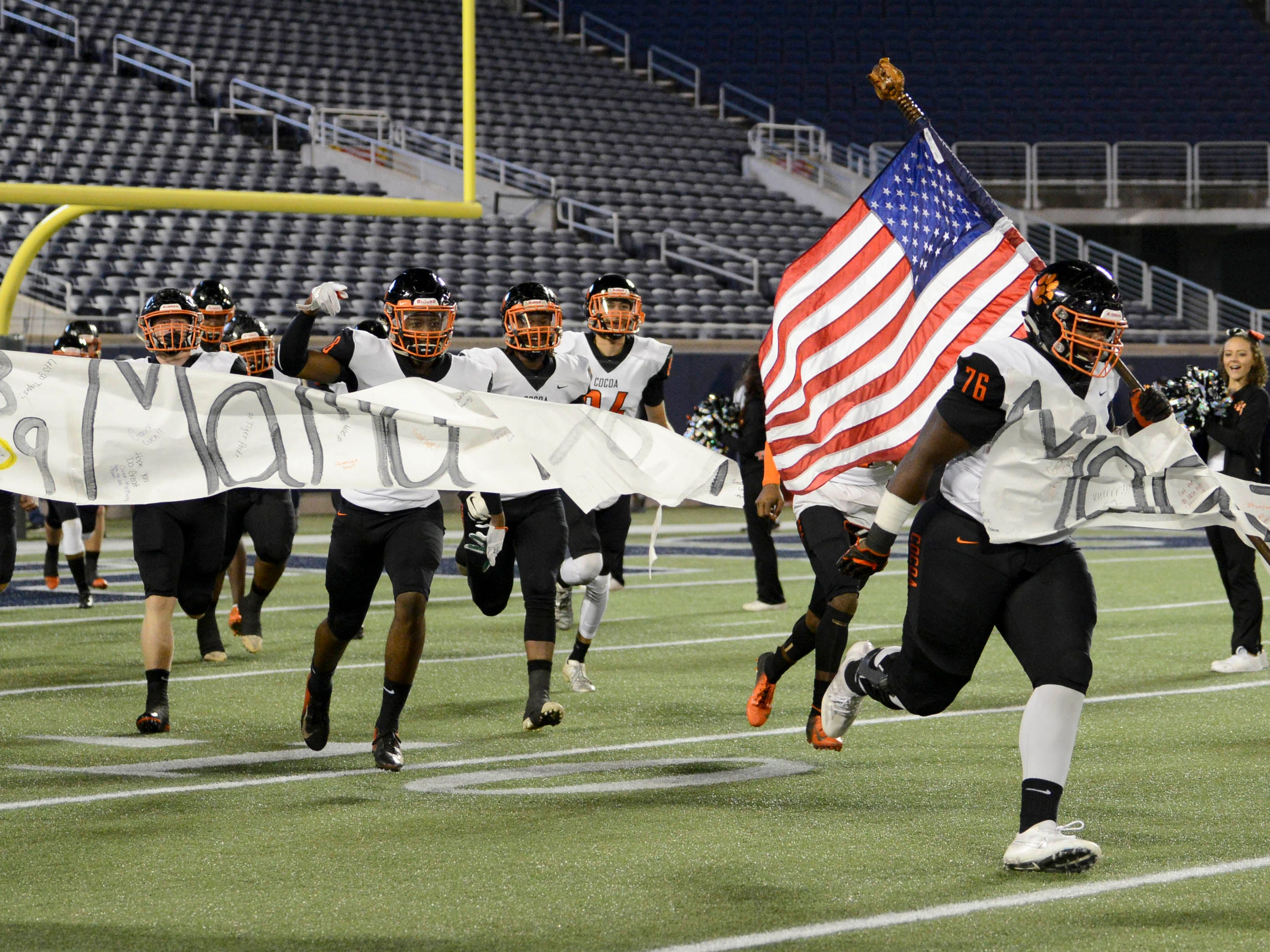 The Cocoa Tigers take the field for Thursday's Class 4A football state championship.