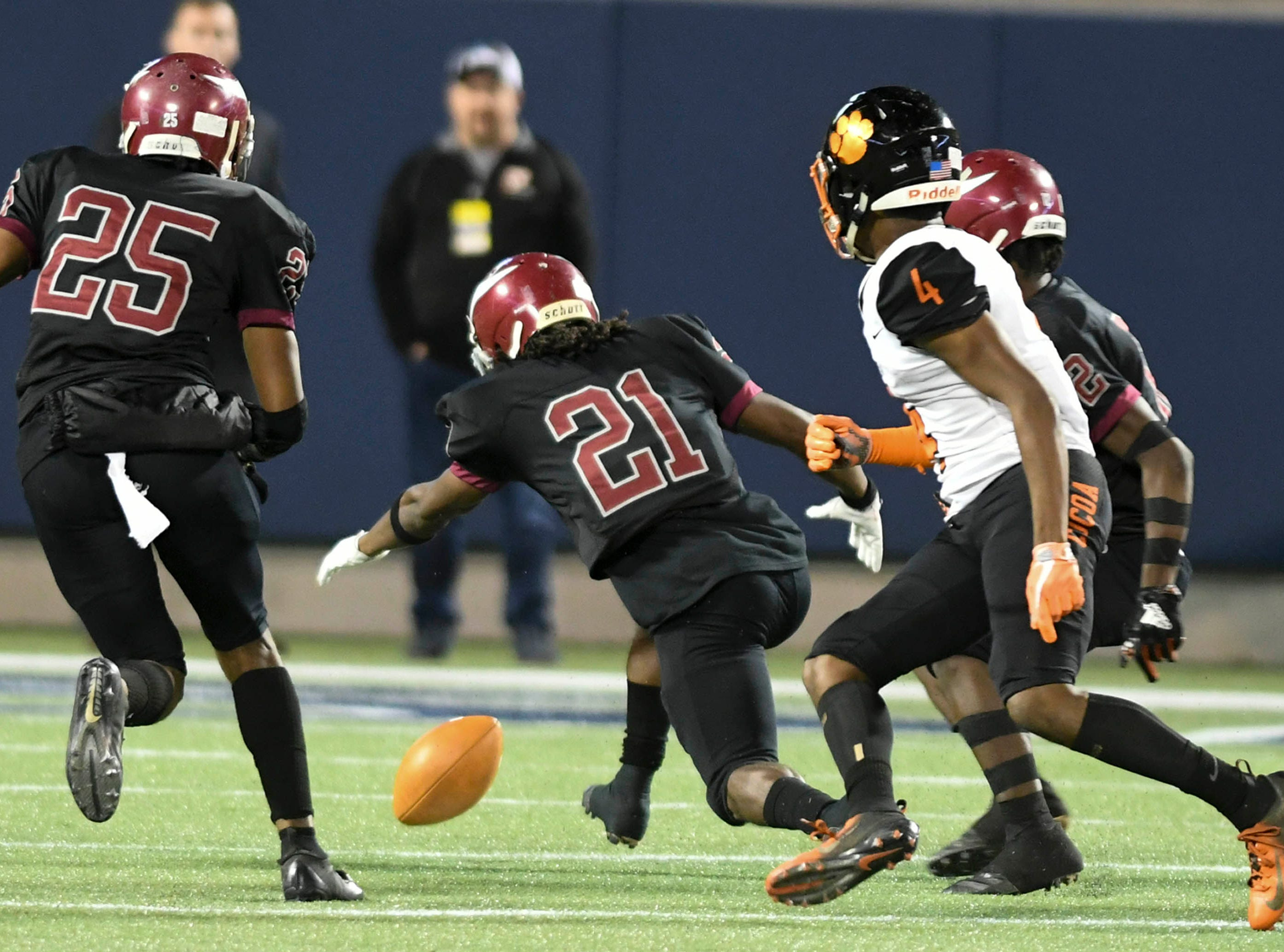 Nazario Jones of Raines (21) falls on a Willie Gaines fumble during Thursday's Class 4A football state championship.