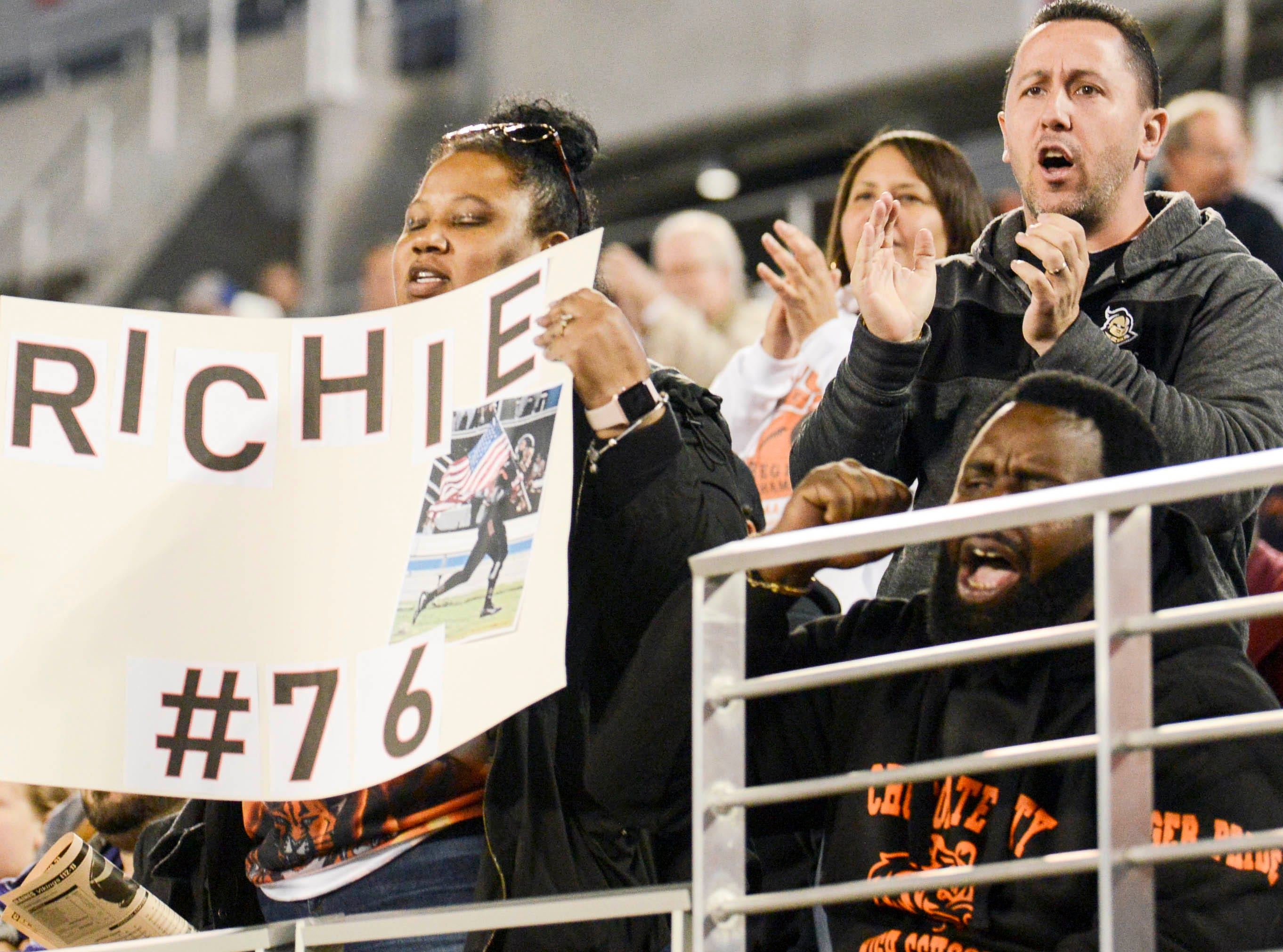 Fans cheer for the Cocoa Tigers during Thursday's Class 4A football state championship in Orlando.