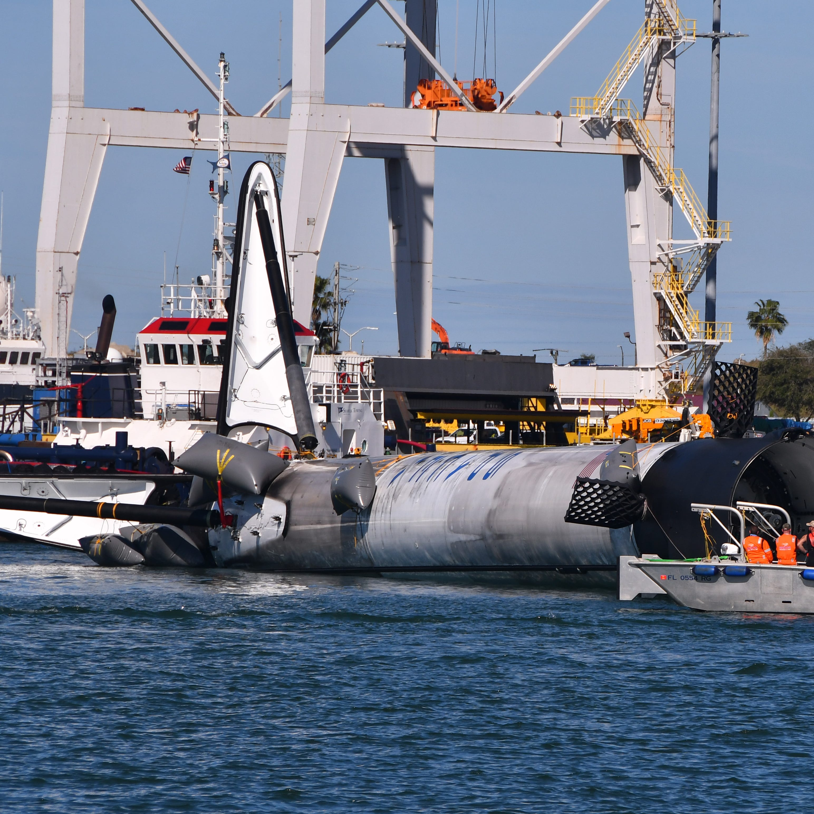 SpaceX booster that failed to stick Cape landing towed into Port Canaveral