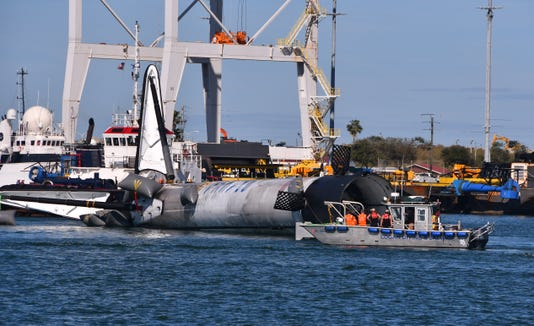 Spacex Booster Towed Into Port