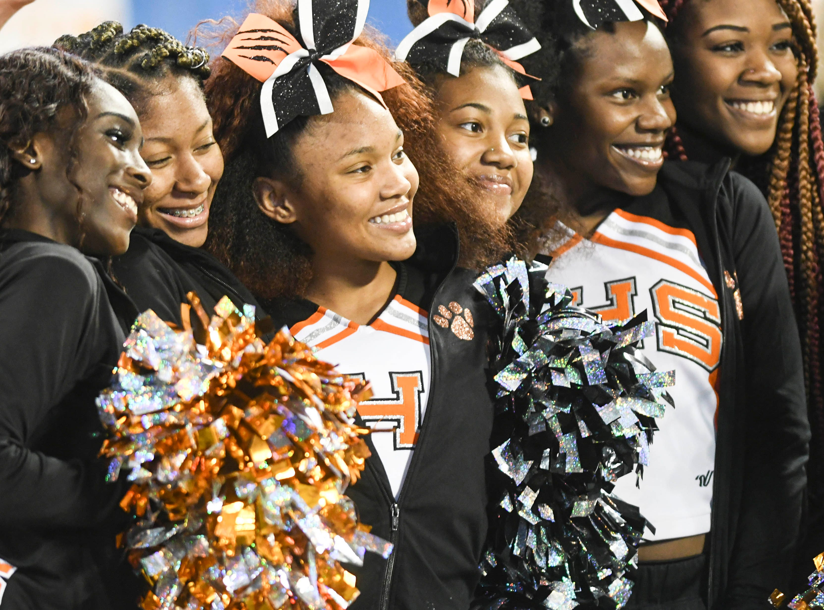 Members of the Cocoa High cheerleading squad pose for pictures during Thursday's Class 4A football state championship.
