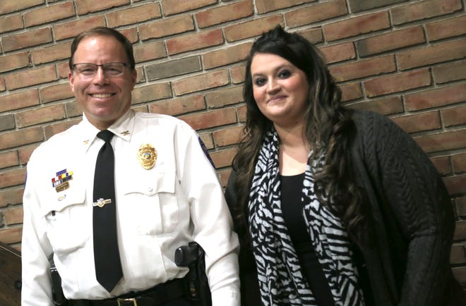 Operation Hope's Santana Stamper stands with Bucyrus Police Chief David Koepke in 2018.