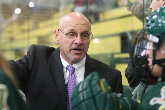 University of Vermont women's hockey coach Jim Plumer talks to his bench during a game earlier this season.