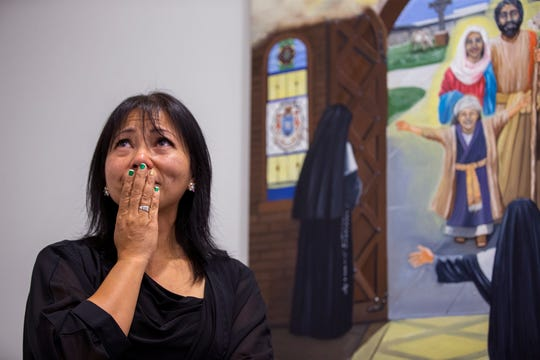 Mercedes McCoy becomes emotional as she speaks about the painting process for two paintings that were unveiled in the chapel of the Dr. Hector P. Garcia Memorial Family Health Center on Friday, December 7, 2018. McCoy spent months doing research for the paintings, one of which includes an image of Dr. Hector P. Garcia.