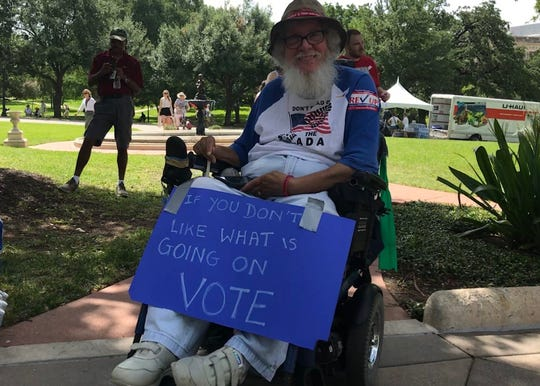 Bob Kafka push for the rights of the disabled on the lawn of the Texas Capitol.