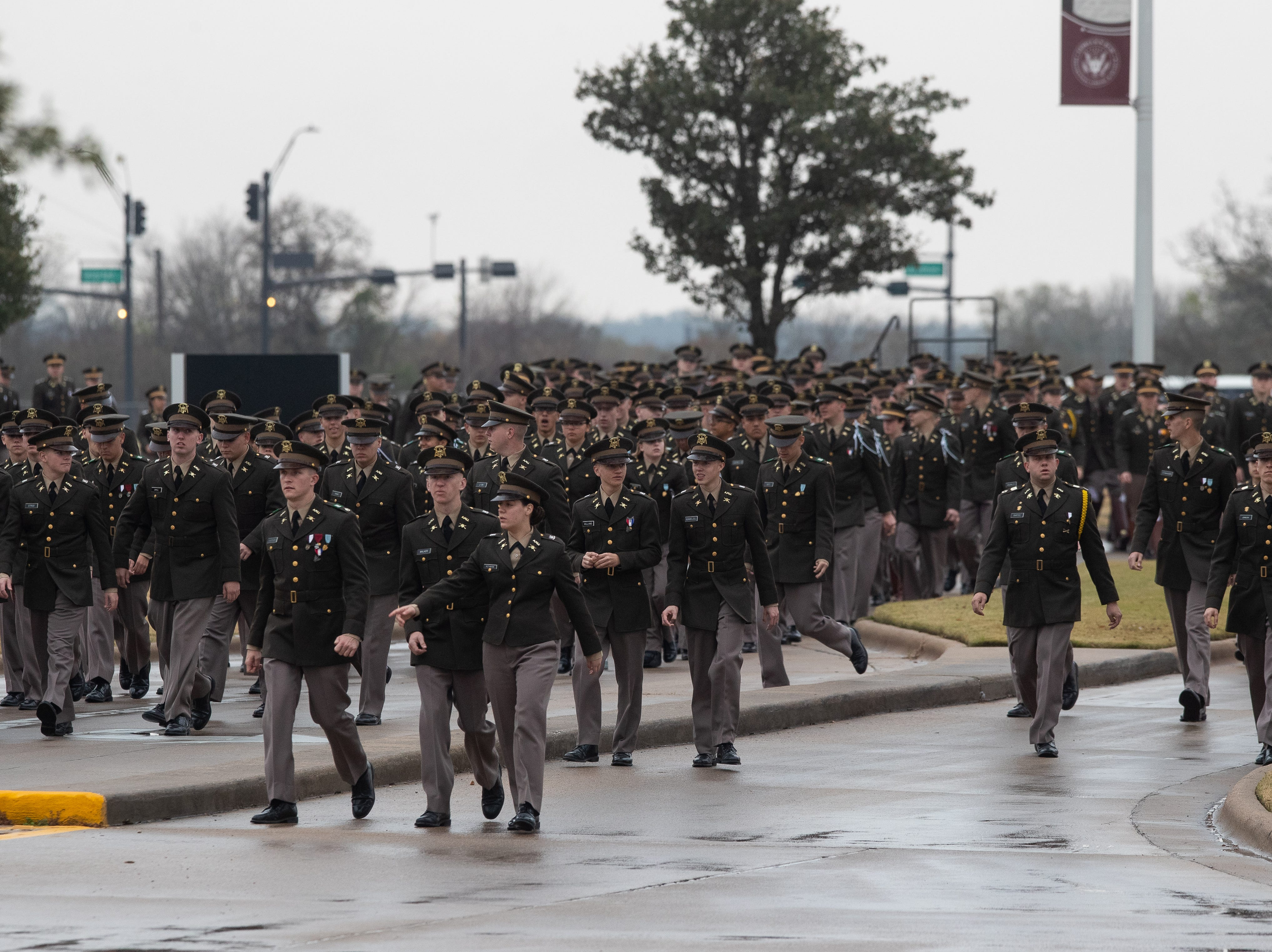 Texas A&M University Corps of Cadets walk down Barbara Bush Drive as they wait for the arrive and interment ceremony of the 41 President of the United States, George H.W. Bush at the George Bush Presidential Library & Museum in College Station on Thursday, Dec 6, 2018.