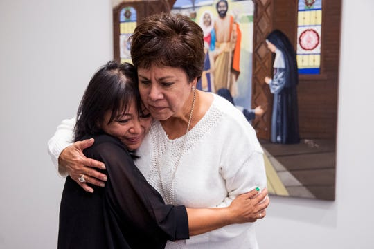Artist Mercedes McCoy (left) gets a hug from Estella Chapa, Chief Transformation Officer for Christus Spohn Health System, after an unveiling of two paintings in the chapel of the Dr. Hector P. Garcia Memorial Family Health Center on Friday, December 7, 2018. McCoy spent months doing research for the paintings, one of which includes an image of Dr. Hector P. Garcia.