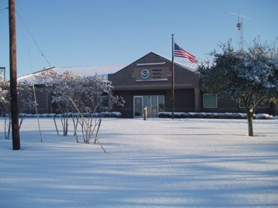 Snow covers the ground outside the National Weather Service at the Corpus Christi International Airport in 2004.