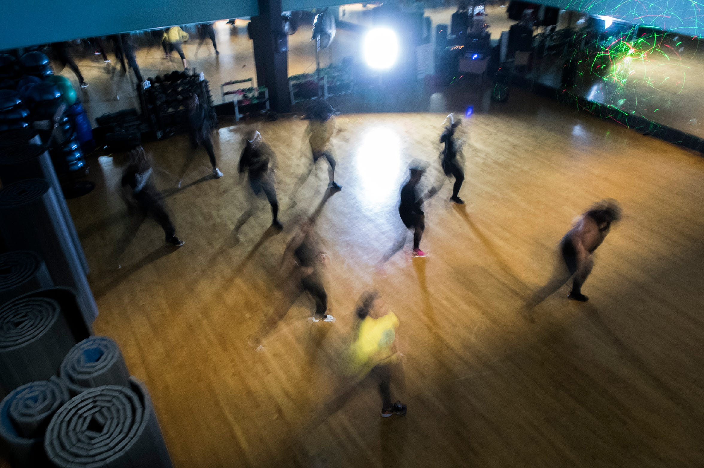 Ciji Carr-McManus and her students work out during a Charged Up Dance Fitness class at in Edgewater Park at JBMFit. The classes include strobe lights, a live DJ and more.