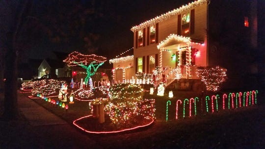 Ryan Oczkowski and his dad have a 20-year tradition of decorating this home on Pickwick Drive in Marlton.