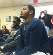 Charles Bell (left) and Manny Edmondson of Camden PowerCorps listen as Attorney General Gurbir Grewal and NJ Department of Environmental Protection Commissioner Catherine McCabe talk about lawsuits targeting polluters in low-income communities.