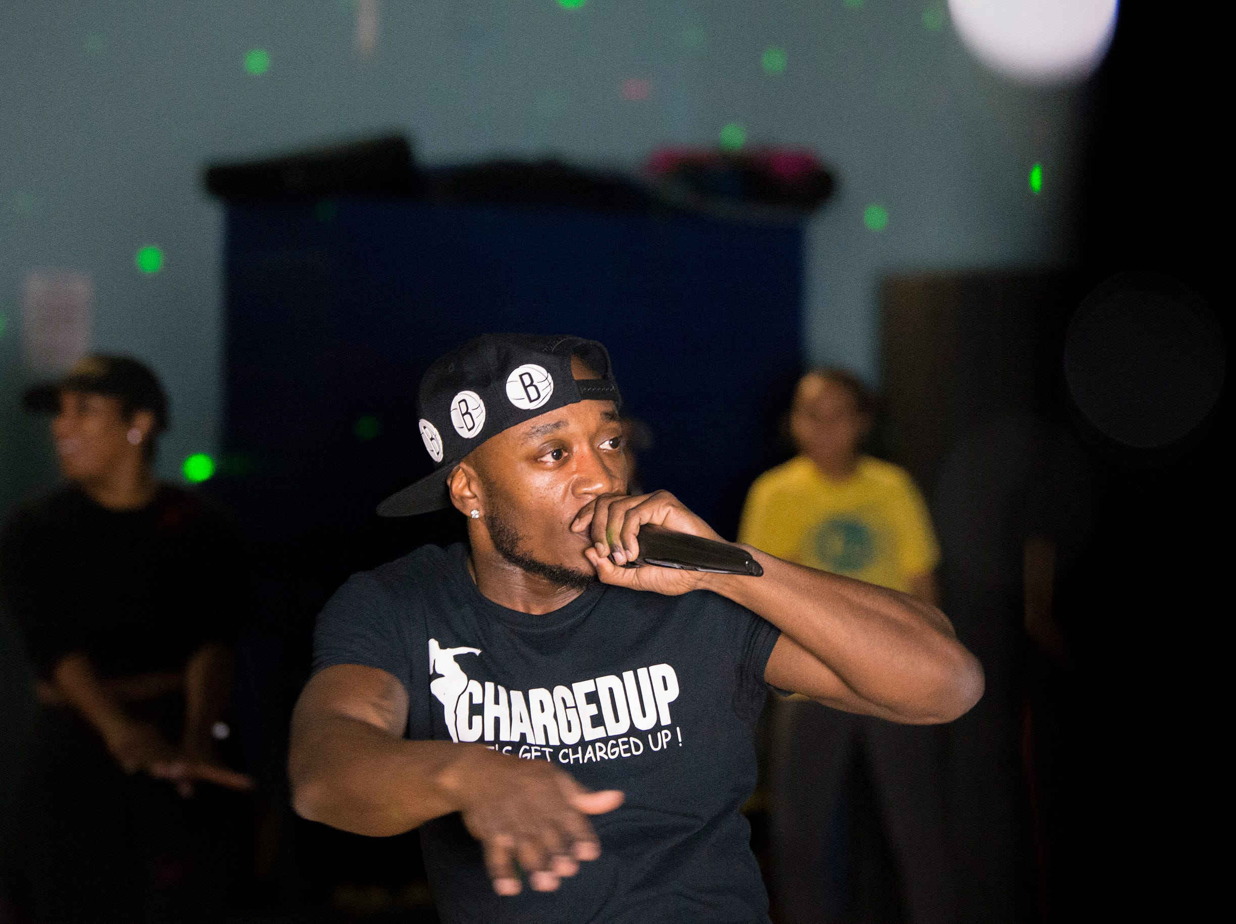 Orlando Chase, known as DJ Melly Mel, DJ's one of Ciji Carr-McManus' classes at JBM Fit in Edgewater Park. It's a 'fitness nightclub' where participants work out with music, strobe lights and more.