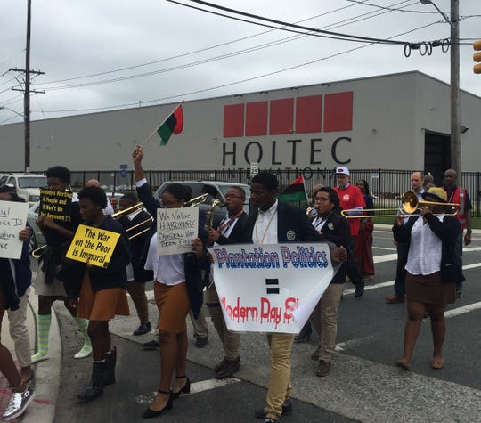 Protesters march outside Holtec headquarters in South Camden in September.