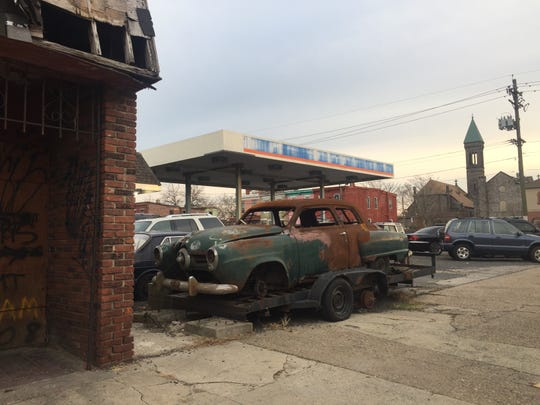 The rotting hulk of a Studebaker sits outside the former Monk's Amoco in South Camden.