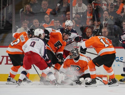 PHILADELPHIA, PENNSYLVANIA - DECEMBER 06: Anthony Stolarz #41 and the Philadelphia Flyers defend the net against the Columbus Blue Jackets during the second period  at the Wells Fargo Center on December 06, 2018 in Philadelphia, Pennsylvania. (Photo by Bruce Bennett/Getty Images)