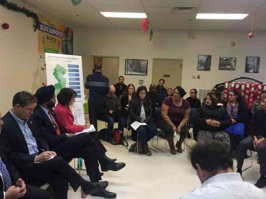 Jacqueline Santiago (center) talks about pollution in North Camden as NJ DEP Commissioner Catherine McCabe and U.S. Rep. Donald Norcross take notes, and NJ Attorney General Gurbir Grewal listens.