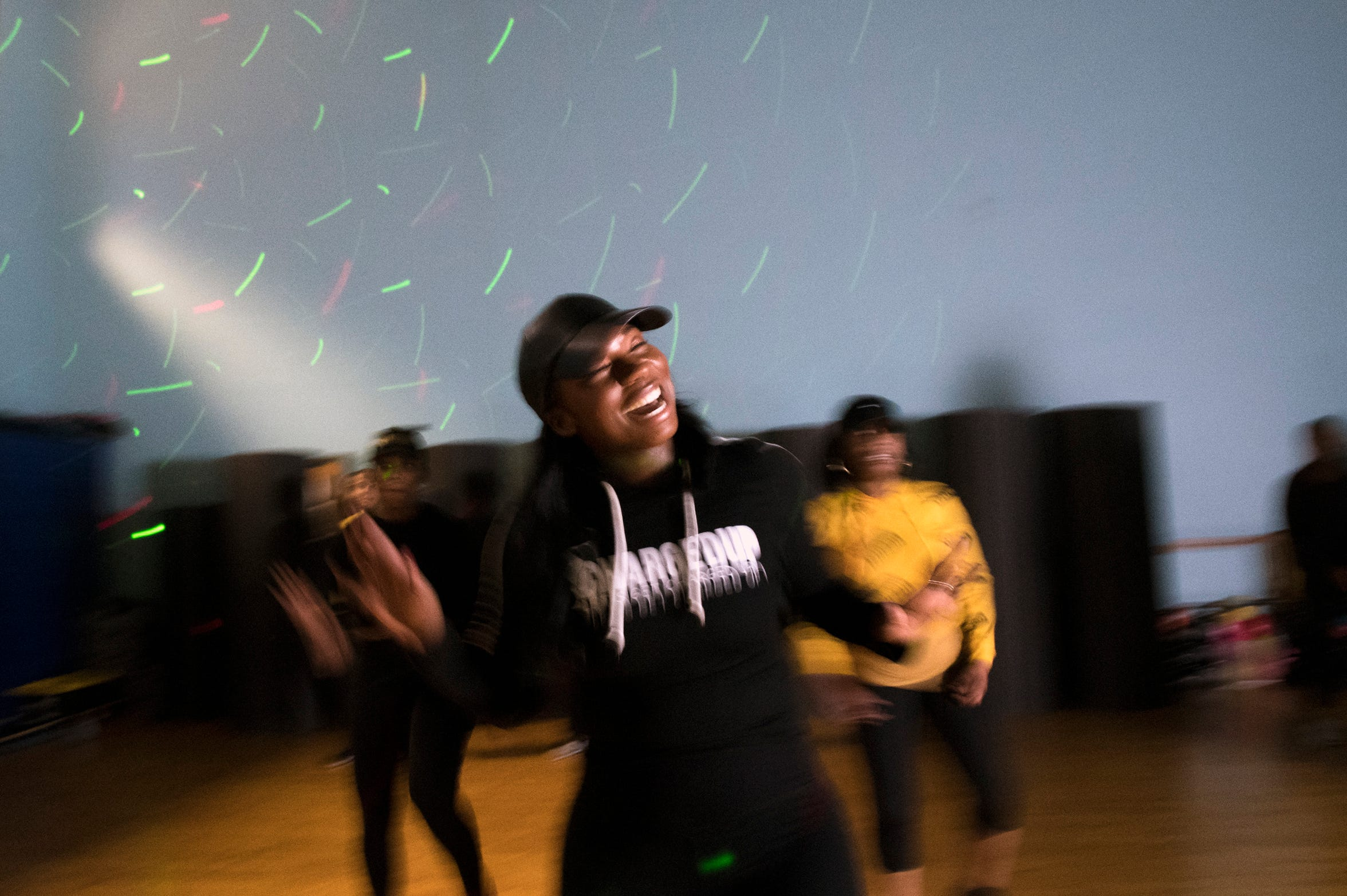 Ciji Carr-McManus, owner and founder of Charged Up Dance Fitness, has fun leading one of her fitness nightclub classes at JBMFit in Edgewater Park in Burlington County.