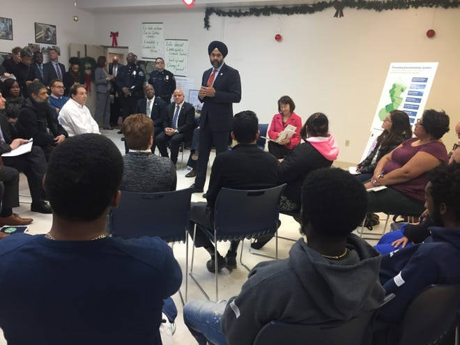 Attorney General Gurbir Grewal talks to residents at a community meeting in Camden.