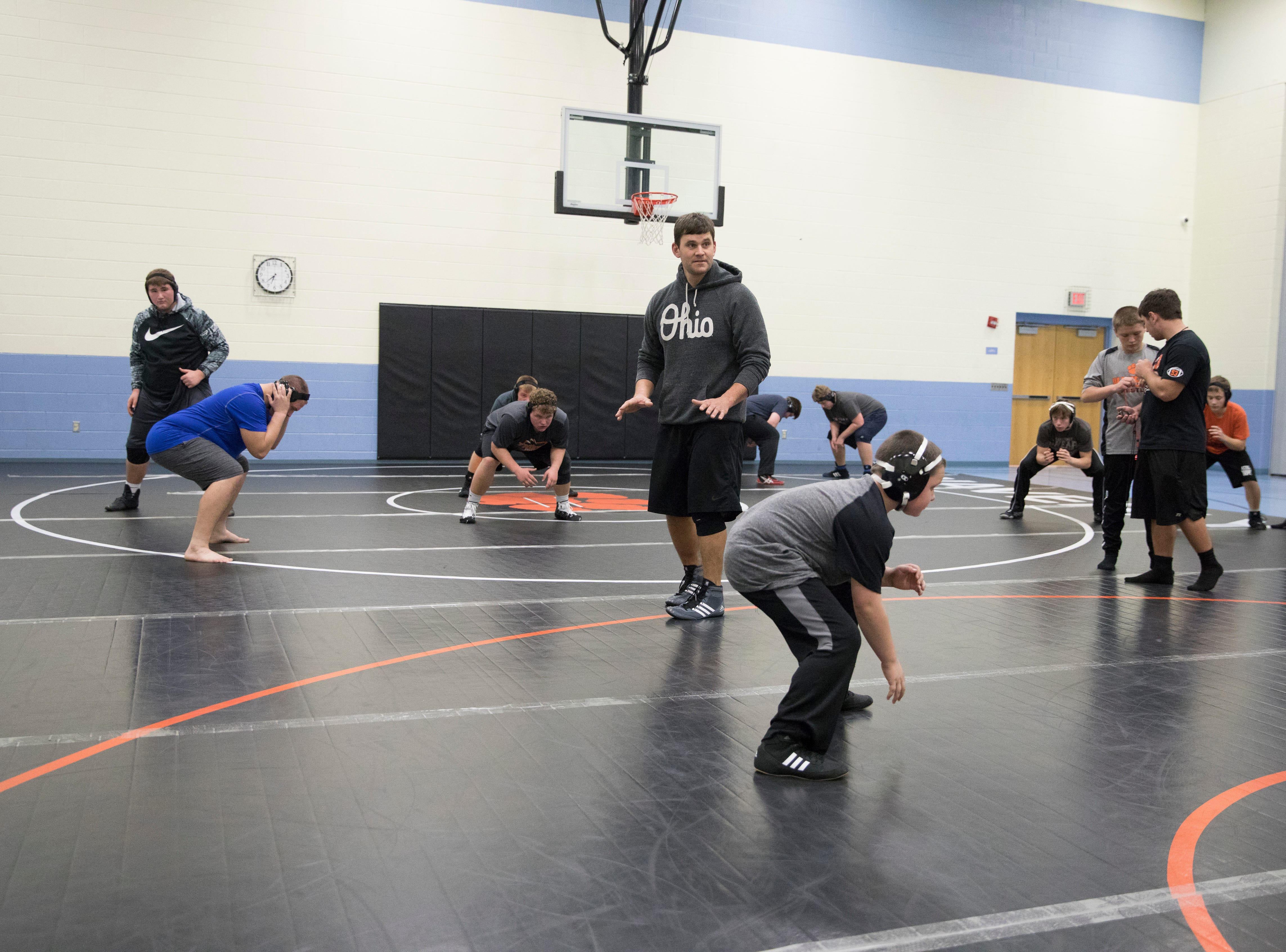 Waverly wrestling coach Scott Green guides wrestlers during practice as he tells them the importance of different wrestling moves that the students can use on their opponents. The Tigers are in their first year of wrestling with almost 40 kids on the team.
