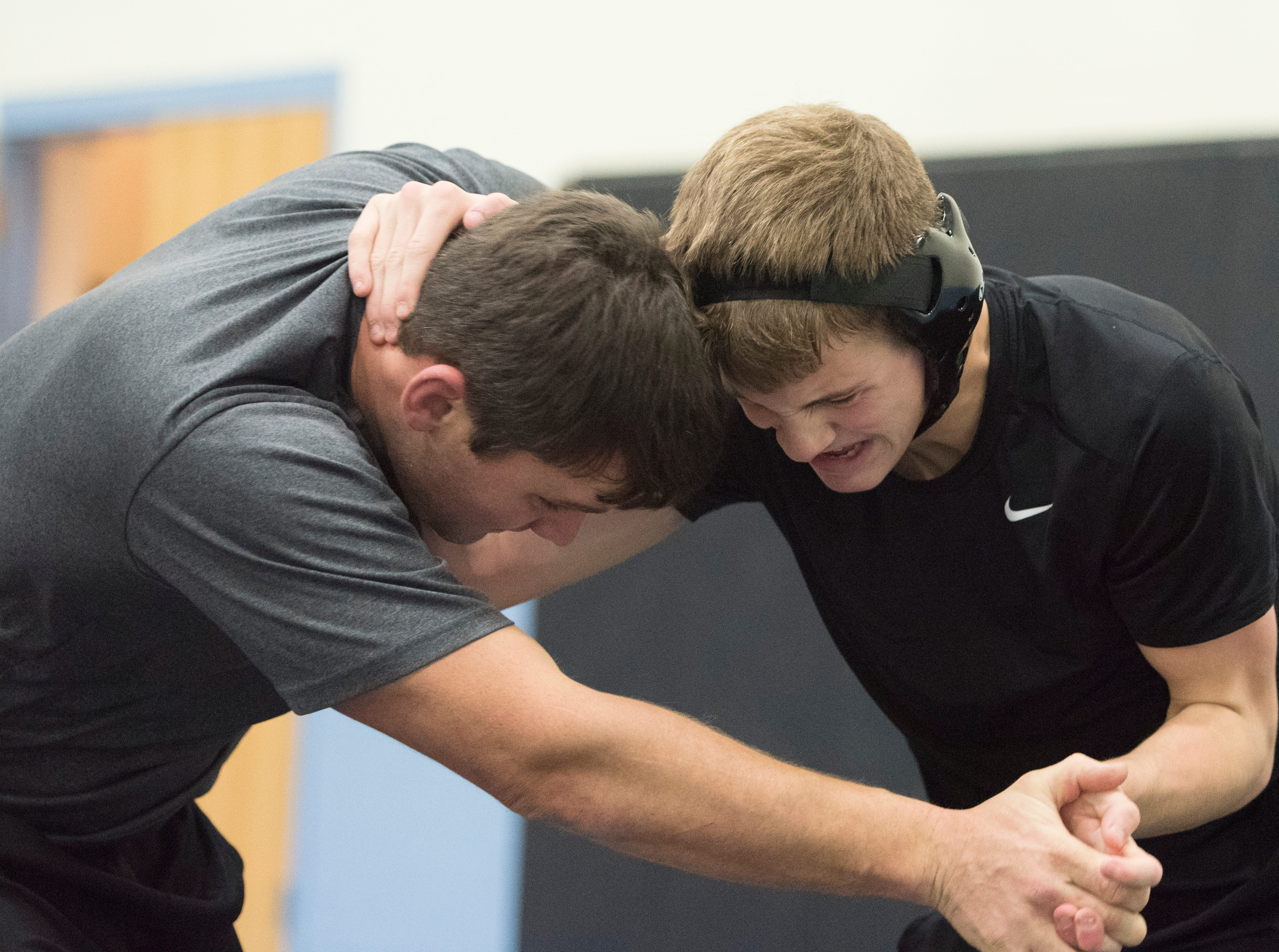 Wyatt Crabtree, right, wrestles with coach Scott Green during wrestling practice as wrestlers change partners to practice different wrestling moves Thursday in Waverly, Ohio.