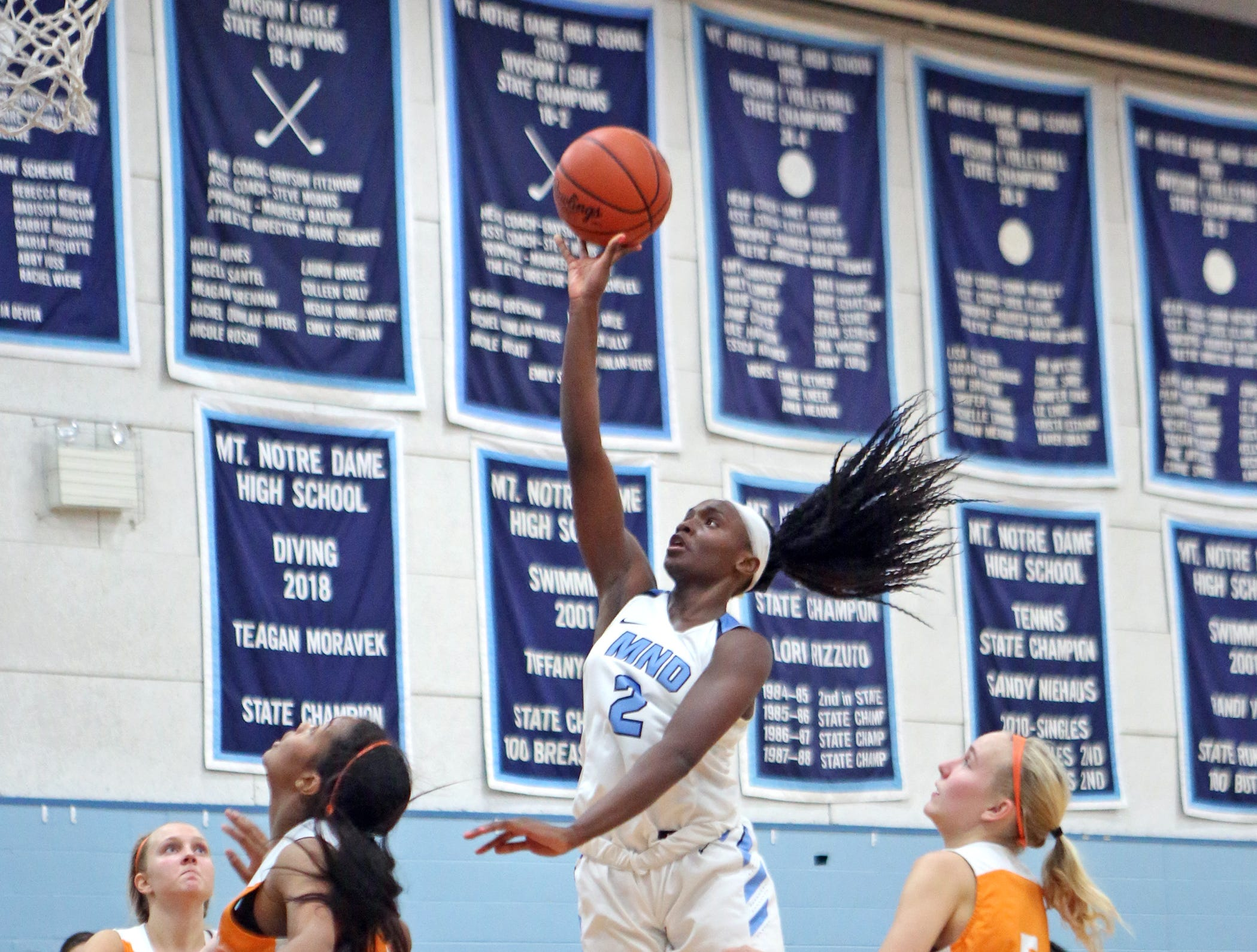 MND freshman guard K.K. Bransford attacks the basket. Mount Notre Dame defeated Mercy-McAuley 53-32.