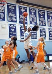 MND freshman guard K.K. Bransford attacks the basket. Mount Notre Dame defeated Mercy-McAuley 53-32.