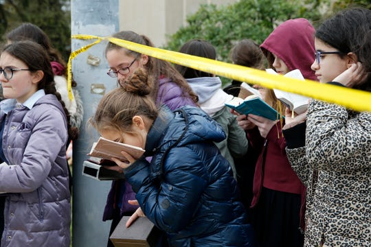 The mass shooting in October at a synagogue in Pittsburgh has been one of the most difficult assignments I have covered in my 23 years of experience. When I saw the young girls praying and singing outside of the synagogue just a few days after shooting, I saw a range of emotions. There was sadness but also strength and hope.   A student from Yeshiva Girls High School kisses her prayer book outside of the Tree of Life Congregation Synagogue in the Squirrel Hill neighborhood of Pittsburgh Monday, Oct. 27, 2018. Two days before, a gunman screamed anti-Semitic epithets as he opened fire on the congregants inside the Tree of Life Congregation. Eleven worshippers were killed, and six others wounded.
