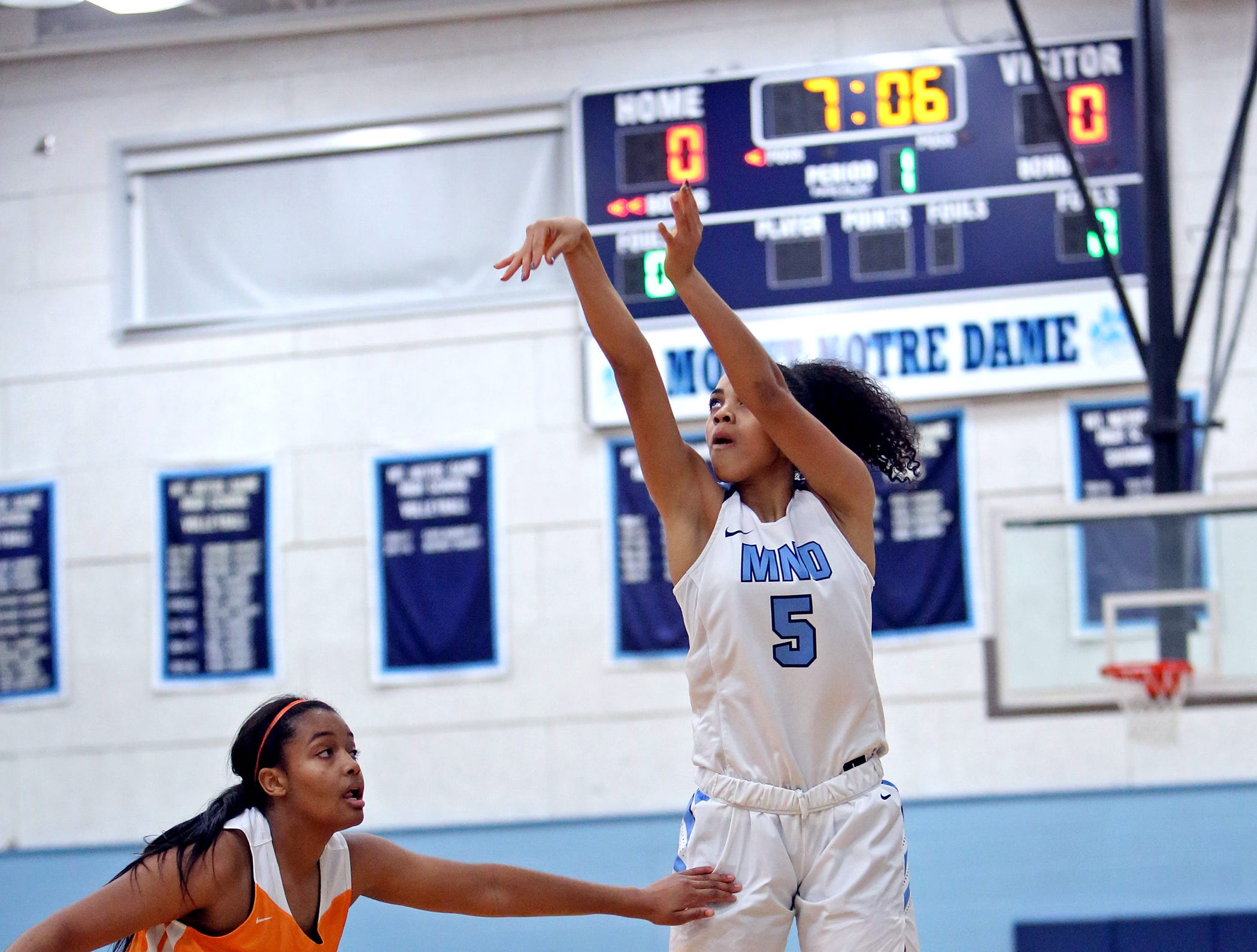 MND guard Laila Phelia knocks down a three point shot. Mount Notre Dame defeated Mercy-McAuley 53-32.