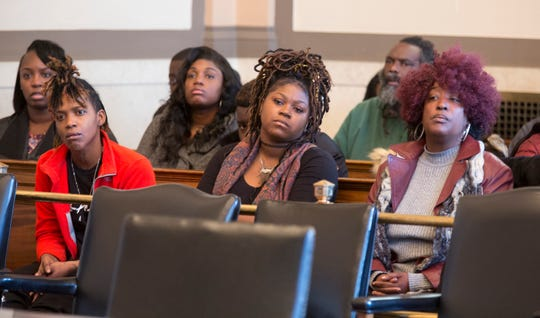 Family and supporters of Cornell Beckley, 28, listen as he's sentenced to 19 years for the Cameo shooting.
