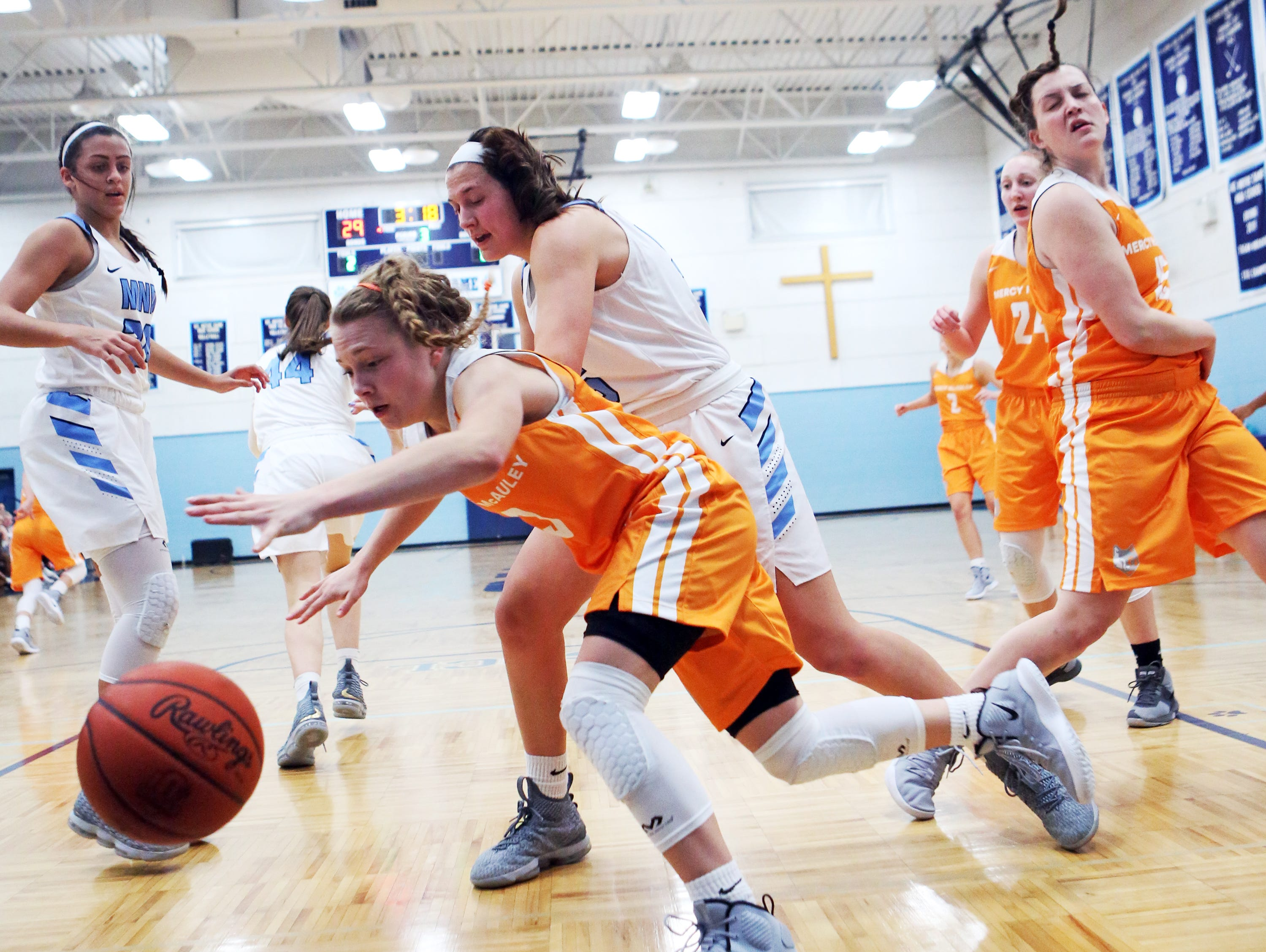 Mercy-McAuley guard Alexa Fleming drives the base line against MND. Mount Notre Dame defeated Mercy-McAuley 53-32.