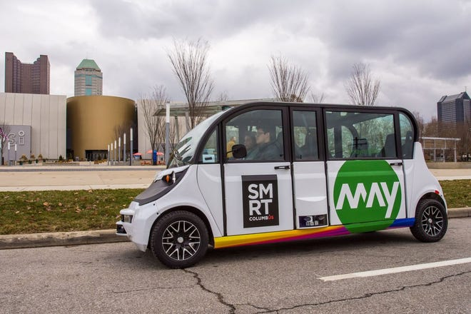 A self-driving shuttle is shown near COSI in Columbus.