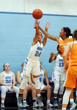 MND guard Gabbie Marshall attempts a three point shot. Mount Notre Dame defeated Mercy-McAuley 53-32.
