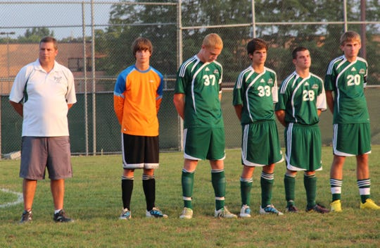 Bishop Brossart head coach Brian Goller (left) and team in a 2011 game