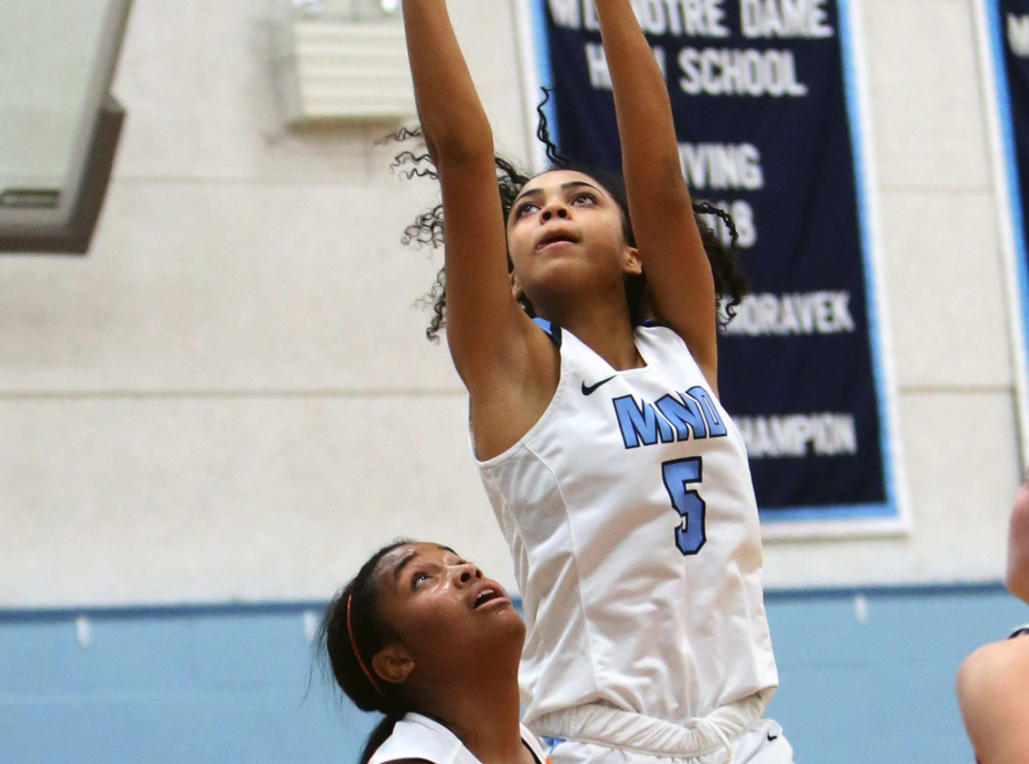 MND guard Laila Phelia attempts a field goal. Mount Notre Dame defeated Mercy-McAuley 53-32.