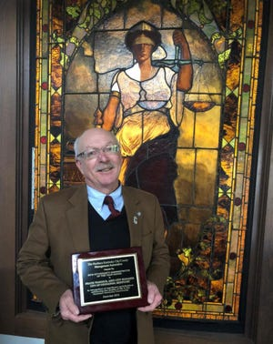 Covington Assistant City Manager Frank Warnock with his award.