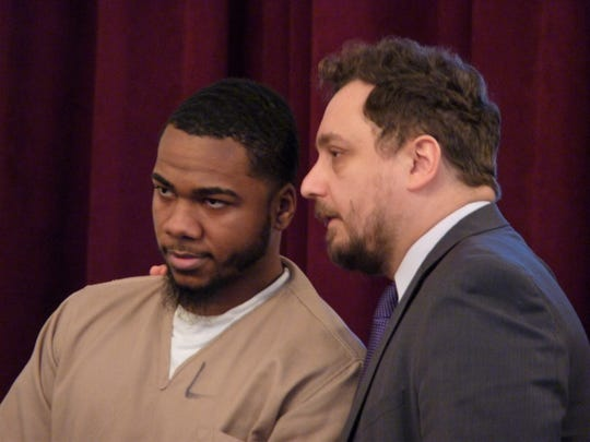 Nathaniel Young Jr. with his attorney, Dino Bjelopoljak, on the day of his sentencing.
