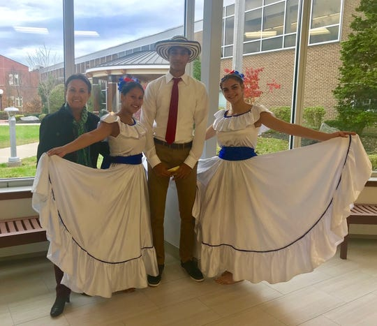 Cumbia dancers Katherine Hernandez of Elizabeth and Antonella Doglio of Carteret prepare for their routine with classmate Ayush Menon of Scotch Plains and AP Spanish teacher Yolanda Reyes of North Plainfield.