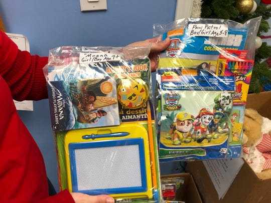 A community member makes these individual activity packets for children as part of the holiday gift drive effort conducted by the United Way of Hunterdon County.
