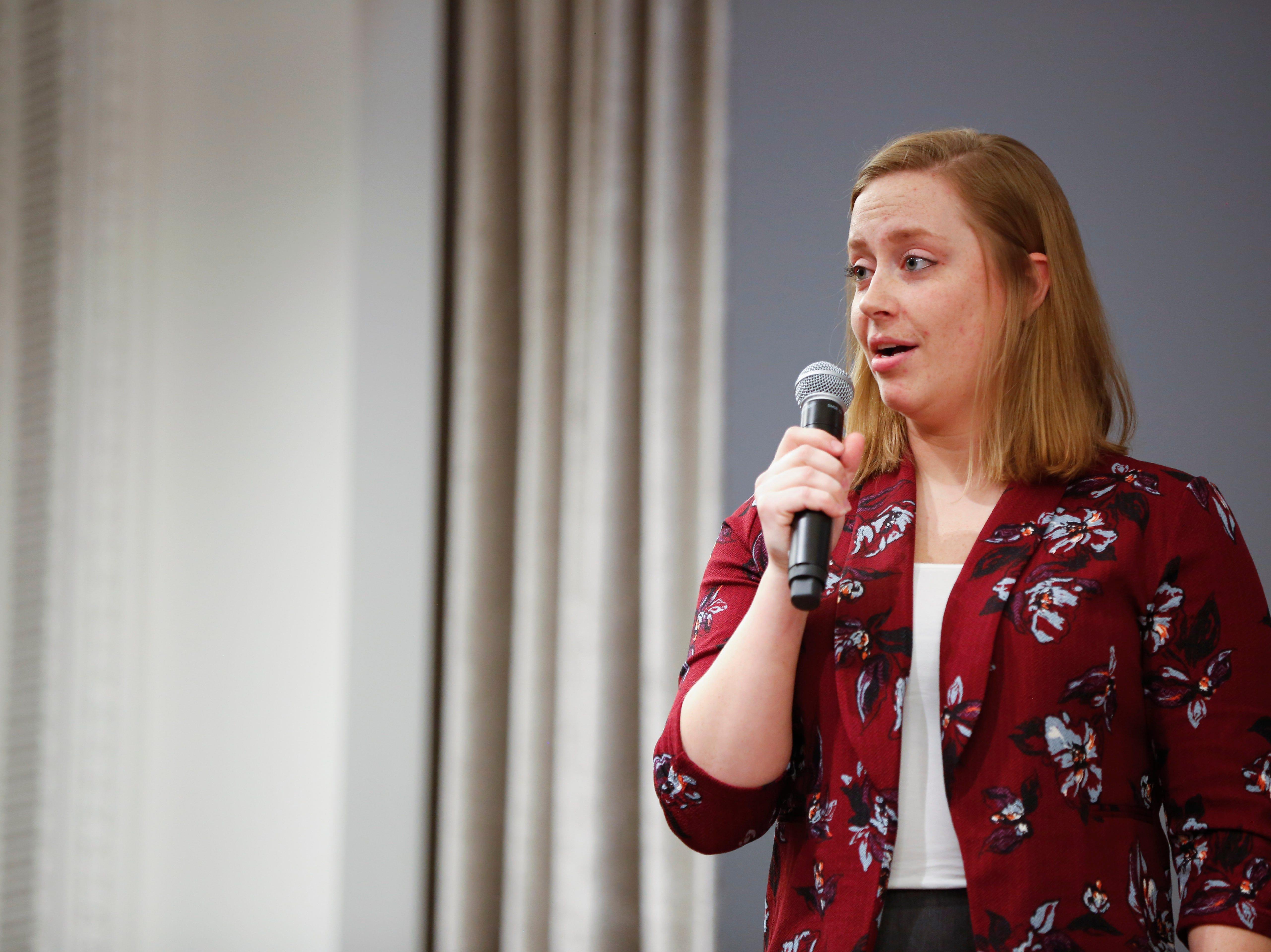 """Miranda Pleggenkuhle speaks at the Des Moines Storytellers' """"War Stories: Battles on the frontline and back home"""" at the Tea Room Thursday, Dec. 6, 2018."""