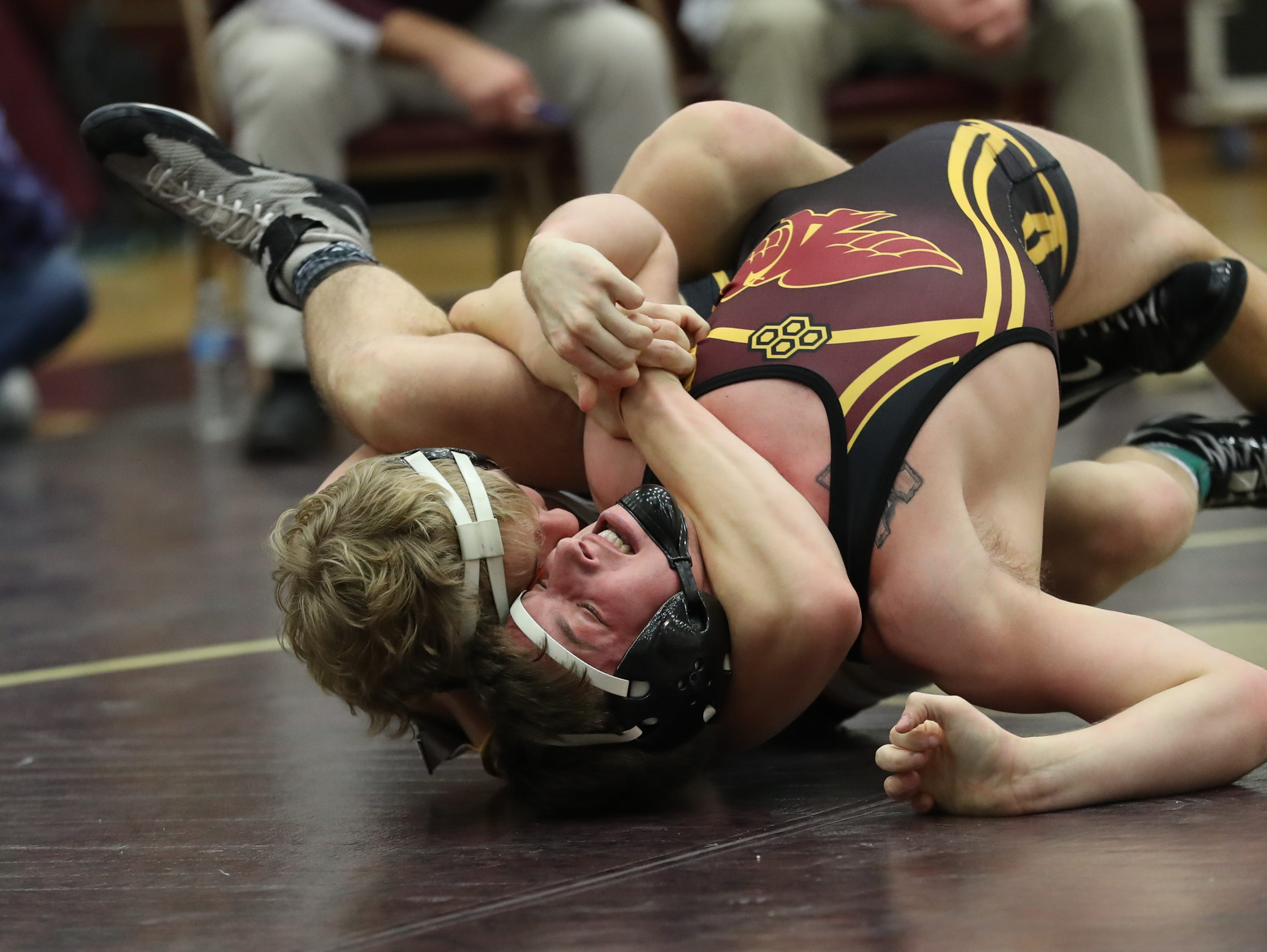 Dec. 4, 2018; Des Moines, IA  USA;  Lance Runyon (Southeast Polk) over Jordan Bales (Ankeny) (Fall 1:10) at Des Moines Lincoln High School. The Rams beat the Hawks 54-14.