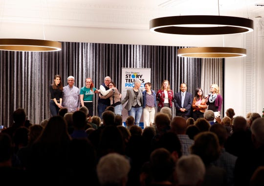 """Speakers and coaches take the state at the Des Moines Storytellers' """"War Stories: Battles on the frontline and back home"""" at the Tea Room in Des Moines on Thursday, Dec. 6, 2018."""